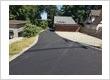 Asphalt driveway with concrete boarders