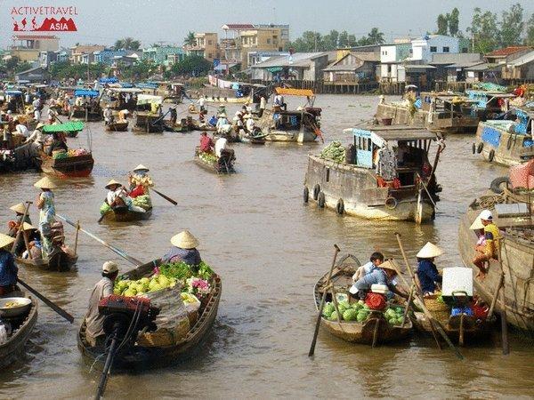 Exploring the largest floating market in Mekong Delta, Vietnam