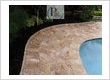 Travertine marble pavers for a residential pool deck remodeling job